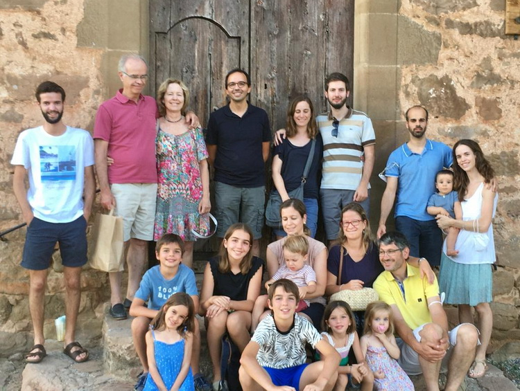 - A family group in front of the church of Pallerols