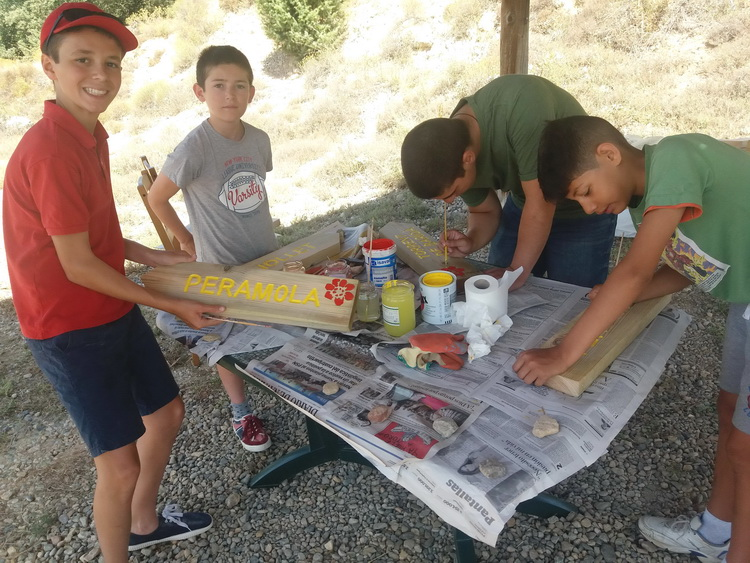 - Painting the signs that will be placed later along the Camino de Andorra to guide the walkers